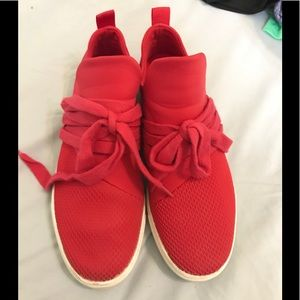 Red pull on sneakers